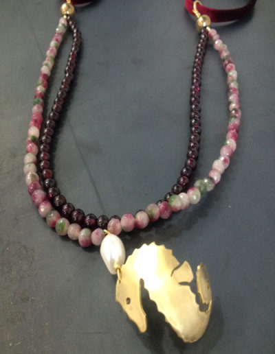 Seahorse crystal garnet pendant